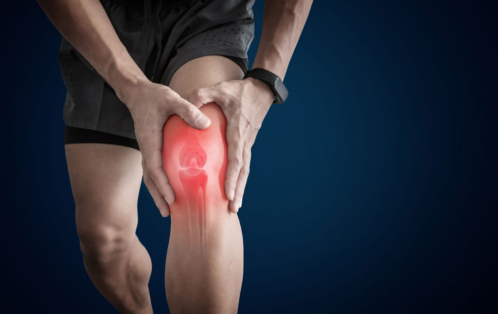 Male with knee pain in red